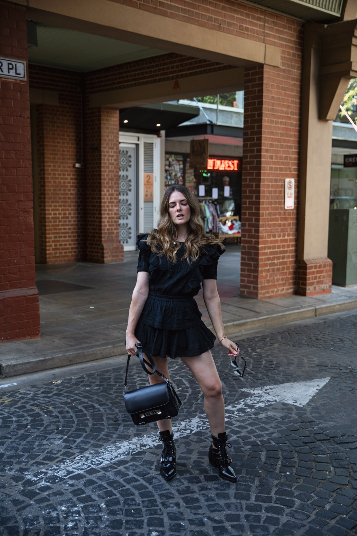 Loveshackfancy black Natasha dress worn with Chloe Rylee boots by fashion blogger Jenelle Witty from Inspiring Wit in Adelaide