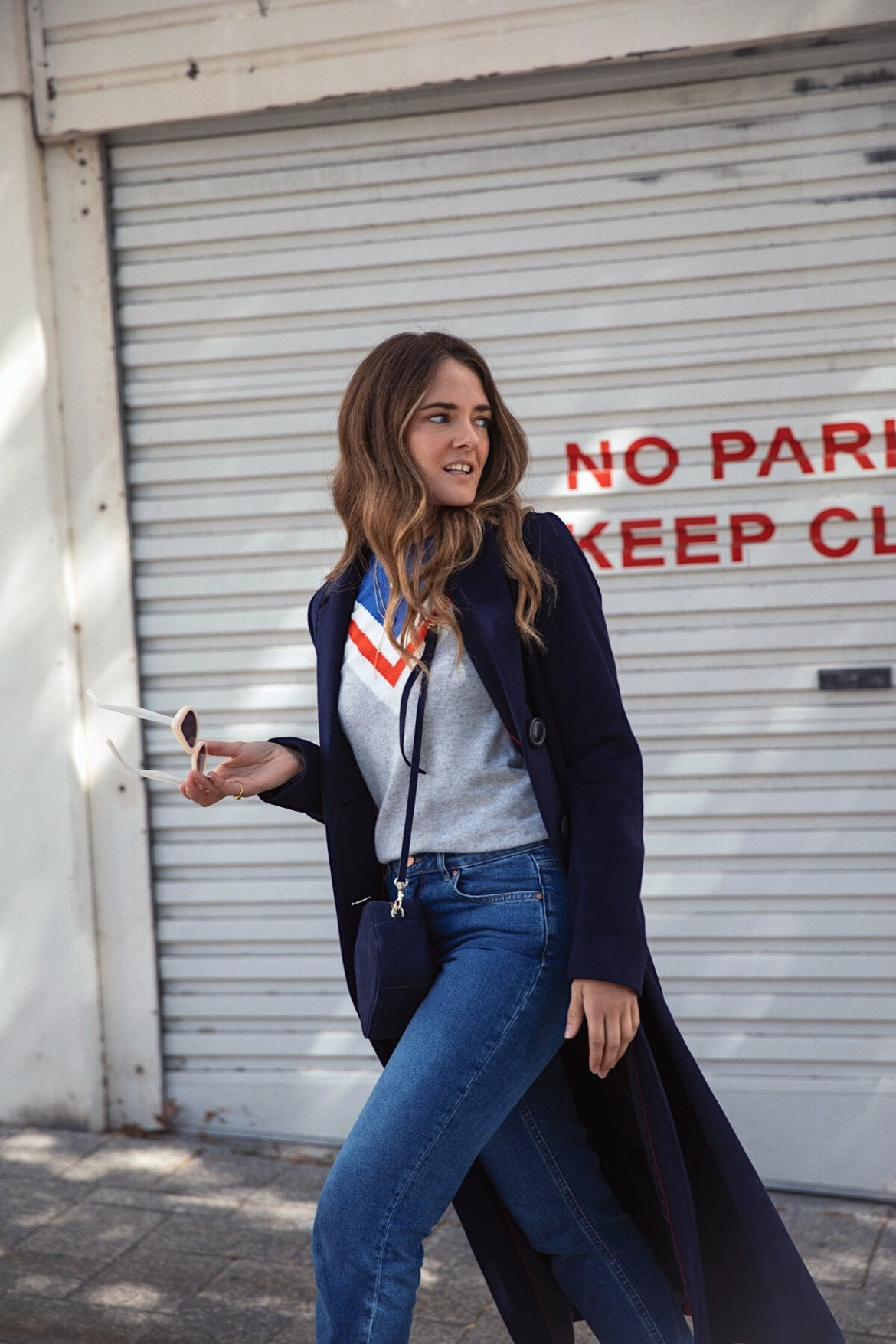 Boden street style outfit with navy coat, cashmere knit, suede heels, cat-eye sunglasses and jeans worn by Inspiring Wit fashion blogger Jenelle