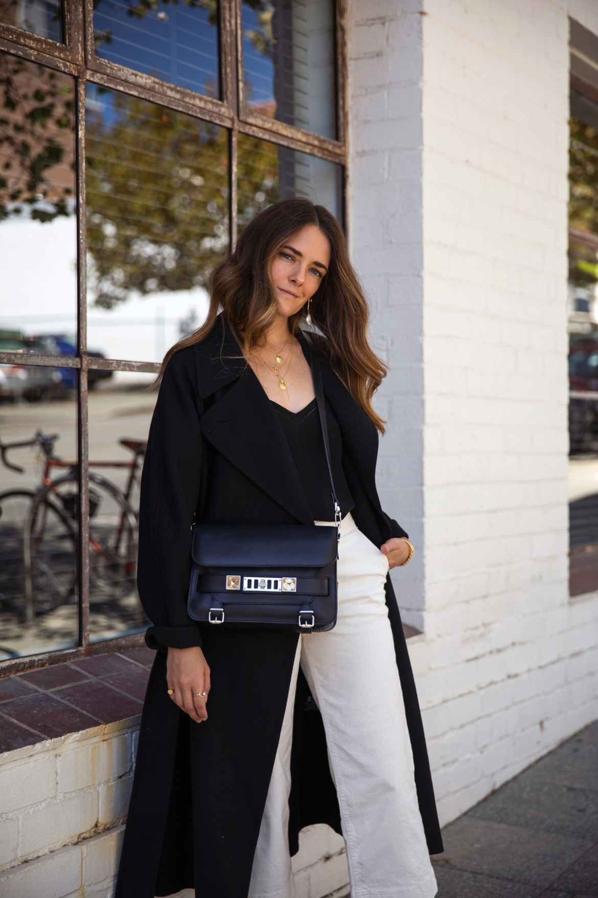 Uniqlo U black coat, Boden silk camisole, cropped jeans, Proenza Schouler PS11 bag outfit worn by Inspiring Wit fashion blogger Jenelle