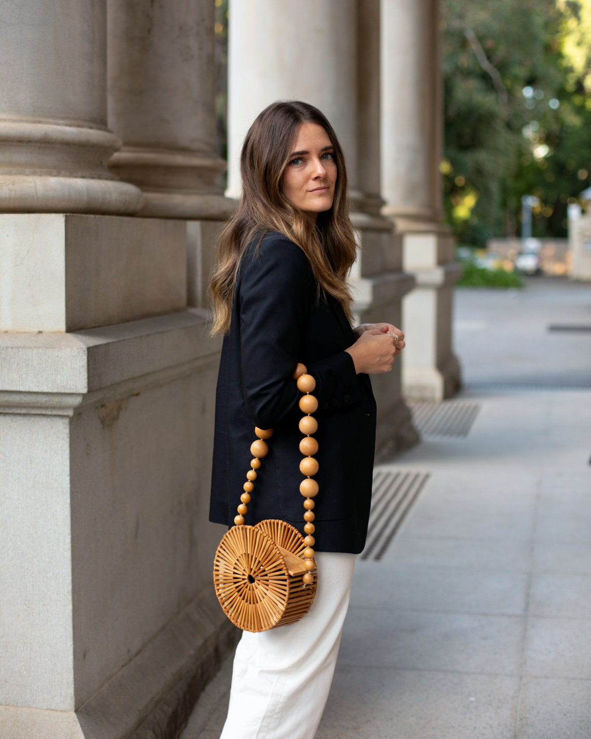 Black blazer, cream pants outfit with bamboo bag from Cult Gaia
