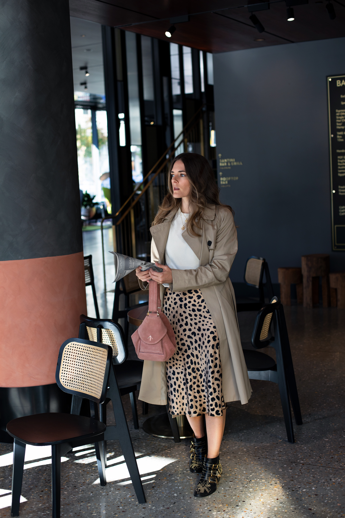 leopard print skirt outfit idea with trench coat