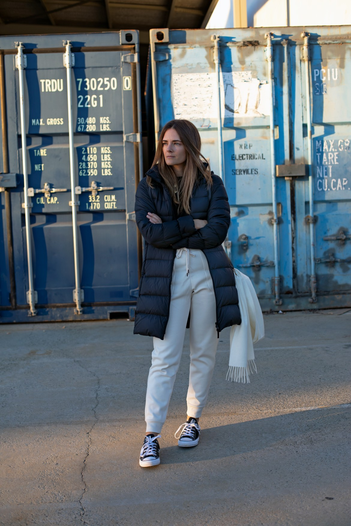 winter relaxed casual outfit idea. ULD Uniqlo puffer coat and jogger pants worn by Inspring Wit fashion blogger Jenelle Witty