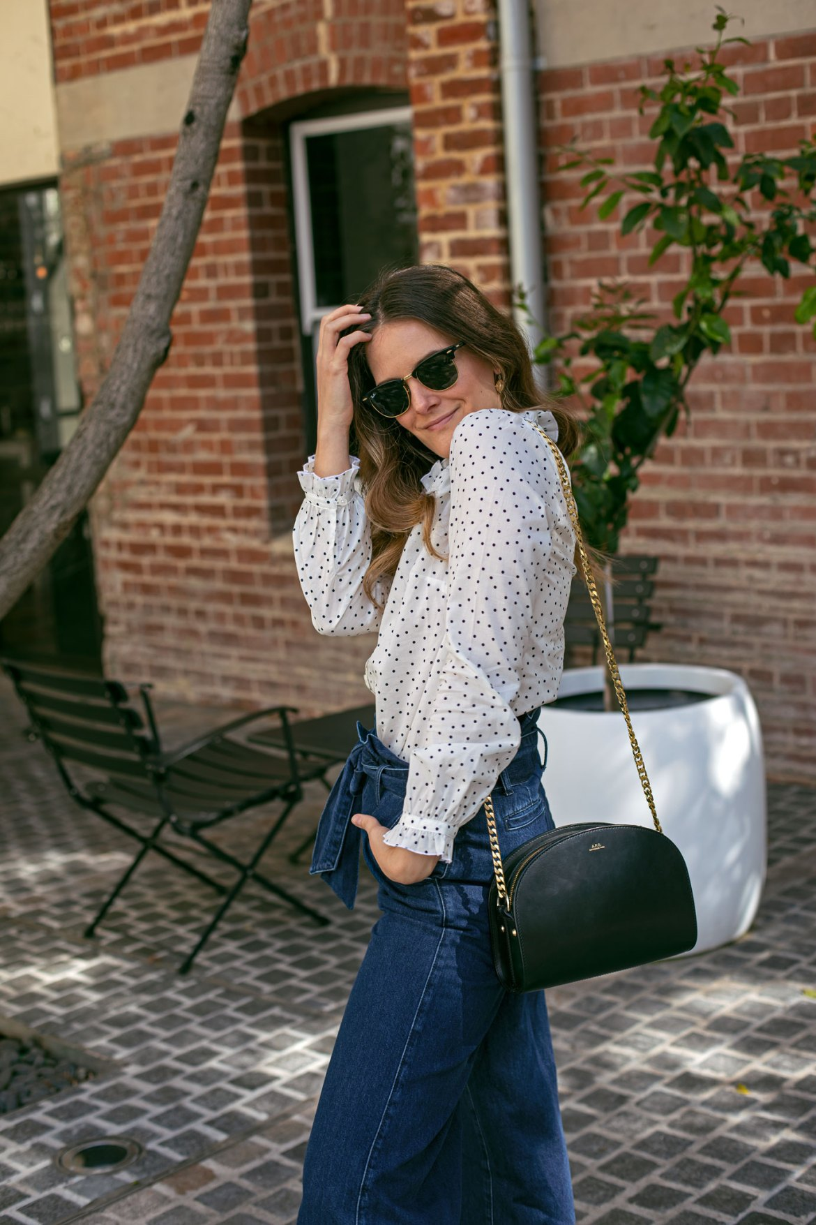 white shirt and denim outfit with A.P.C. bag