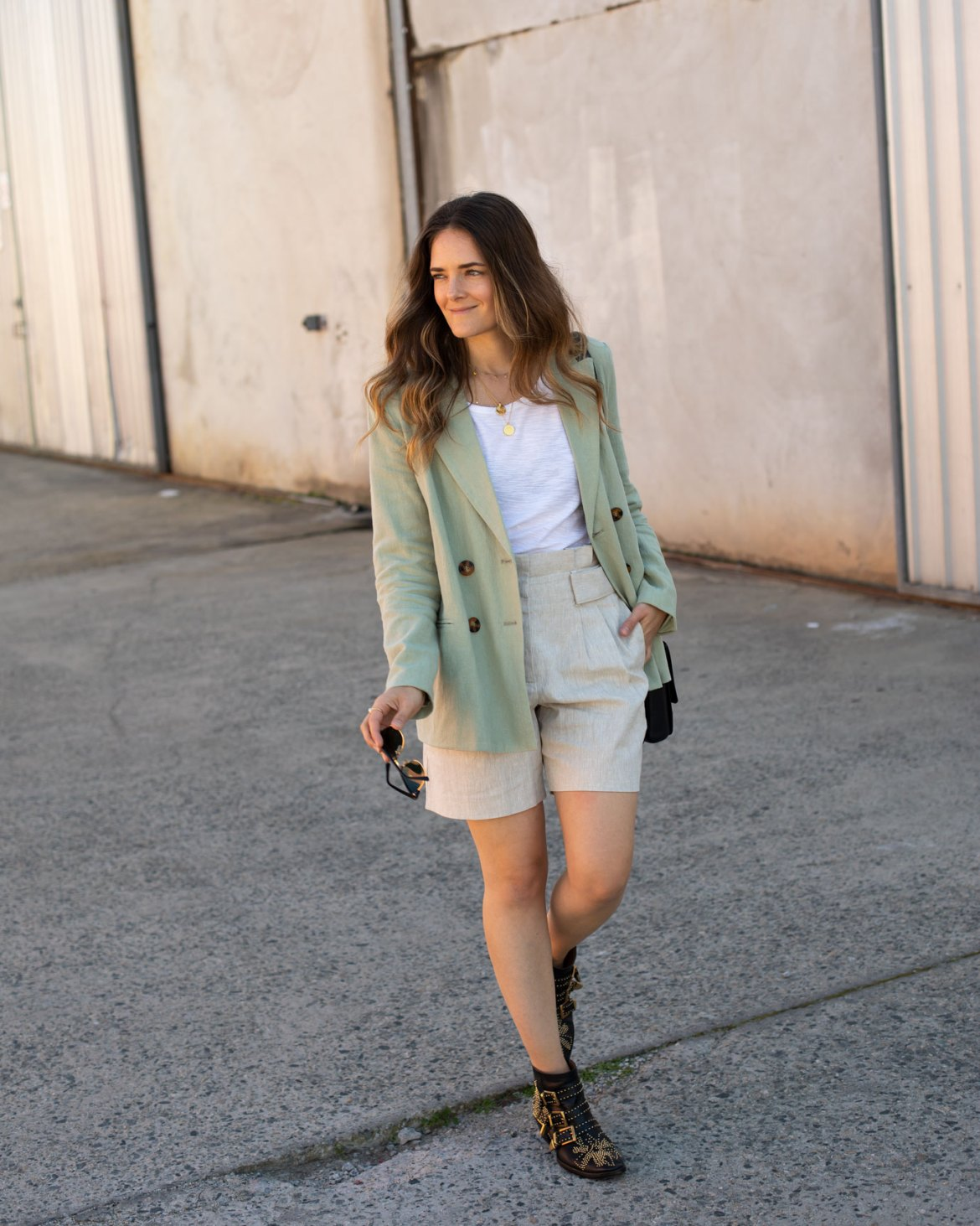 casual neutral linen look with boots article on how I learned to shop less for clothing and appreciate what I have more