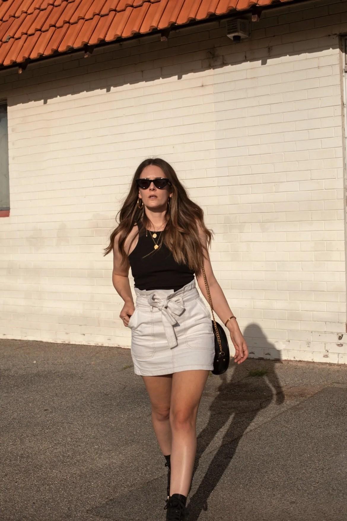 black tank top and cream mini skirt outfit idea