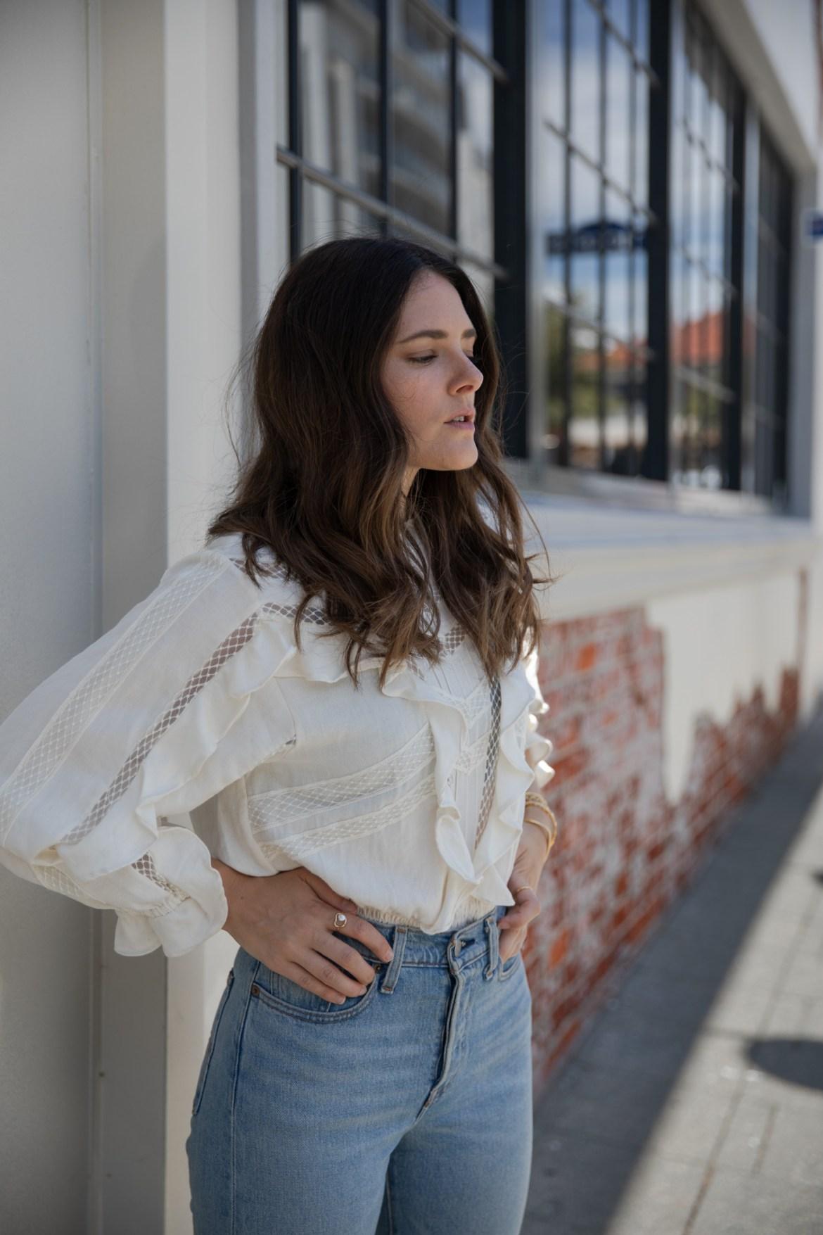 IRO ecru blouse worn with jeans