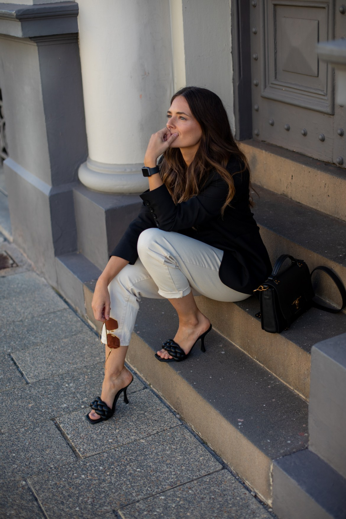 Inspiring Wit fashion blogger Jenelle Witty wearing a black blazer and heels outfit