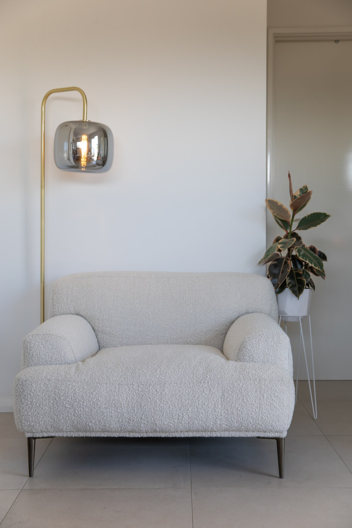 styling the Brosa Seta armchair with a modernist floor lamp and rubber plant for the perfect minimalist home decor