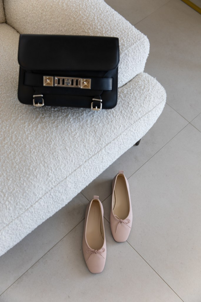Everlane ballet slippers and Proenza Schouler PS11 bag on the Seta armchair from Brosa