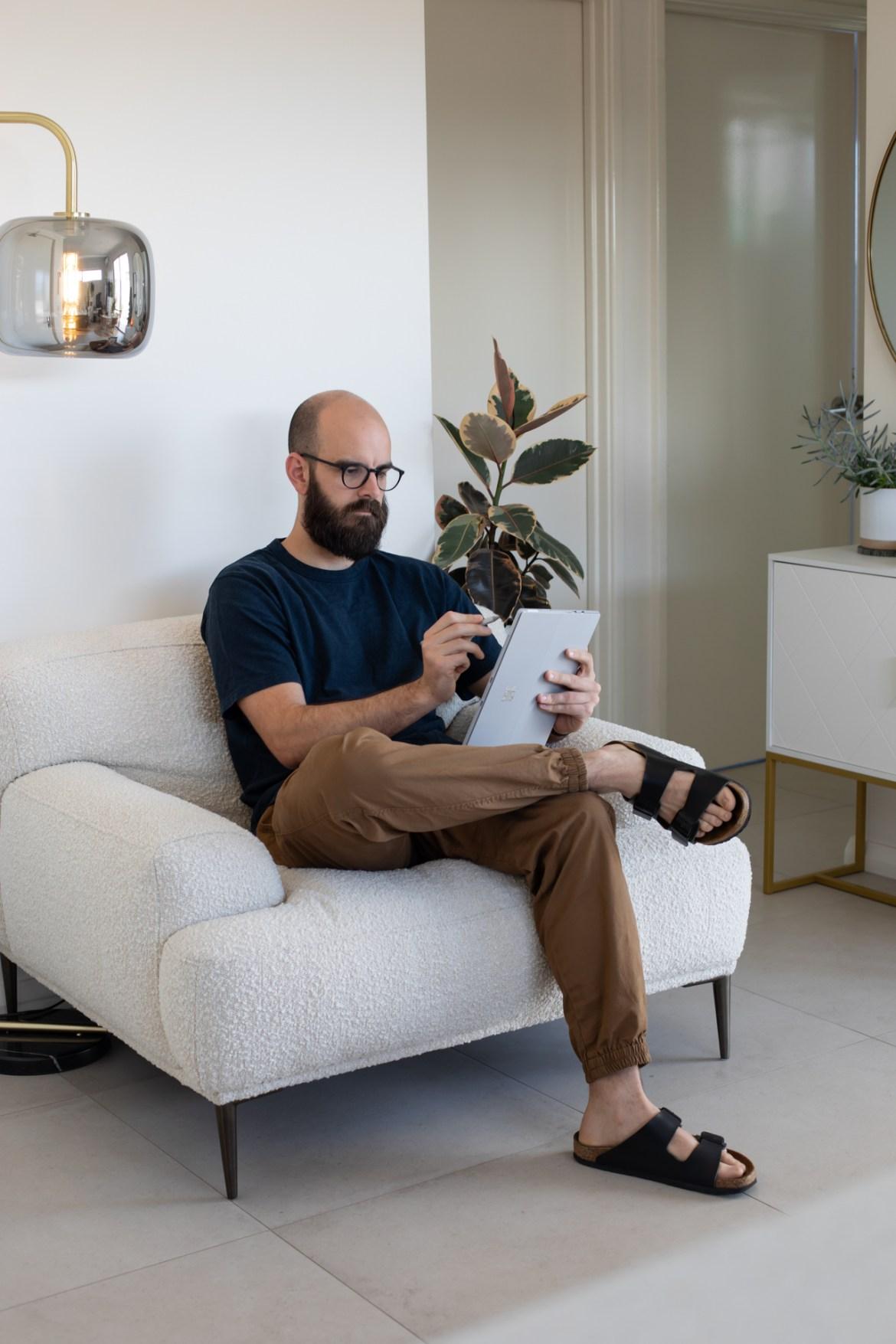 Brosa Seta armchair in boucle at home with graphic designer Mario Recchia