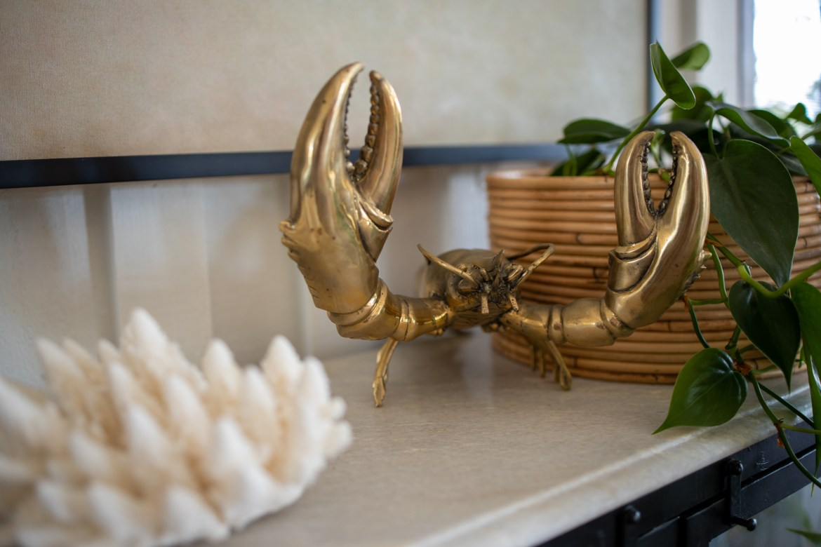 brass crab home decor detail and coral