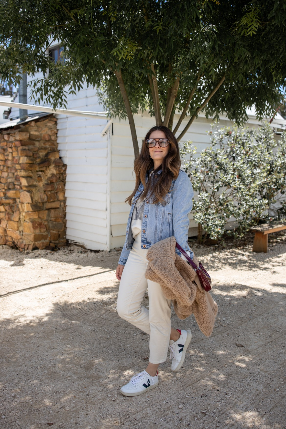 casual outfit with denim jacket and white jeans