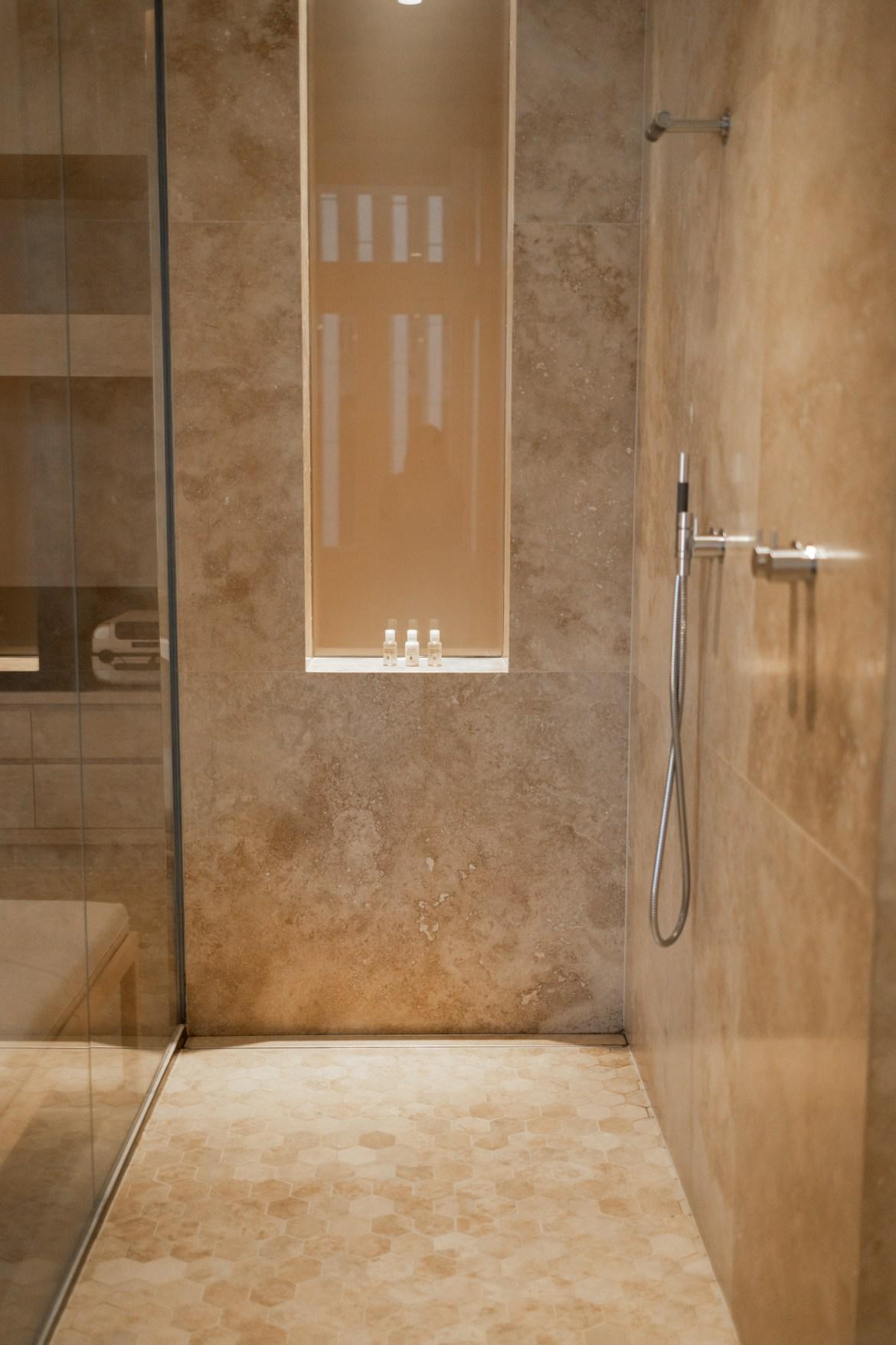 Travertine bathroom shower at Como the Treasury hotel in Perth