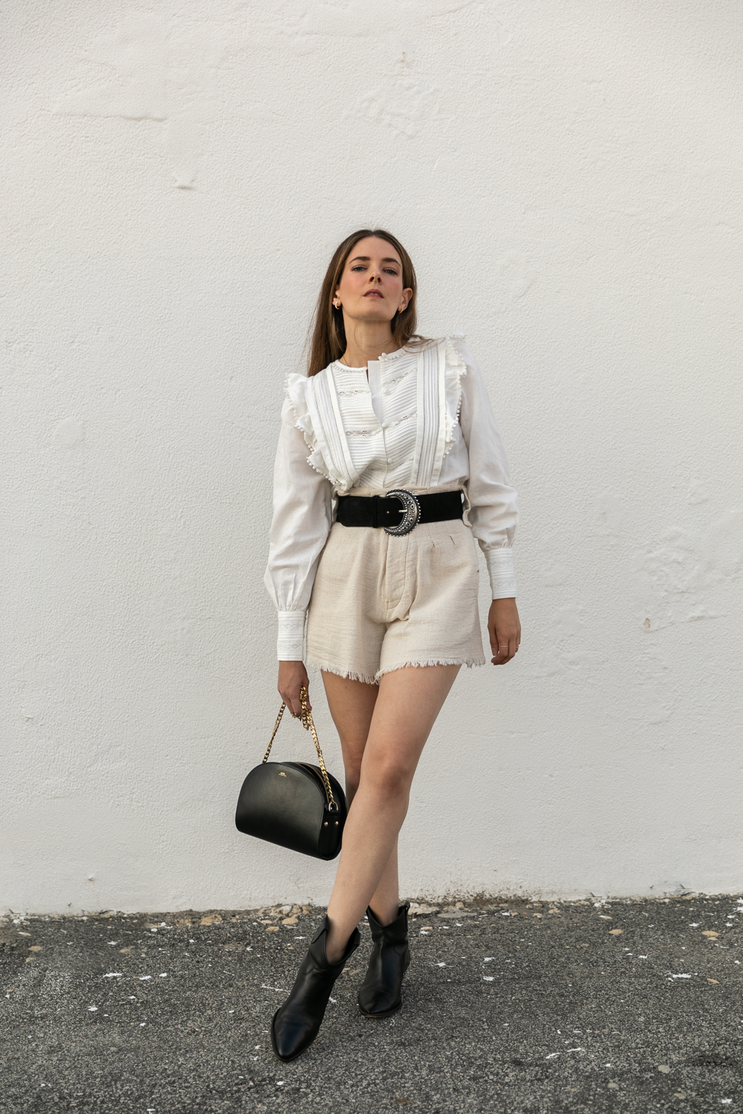 The belt cream blouse I bought from Sezane
