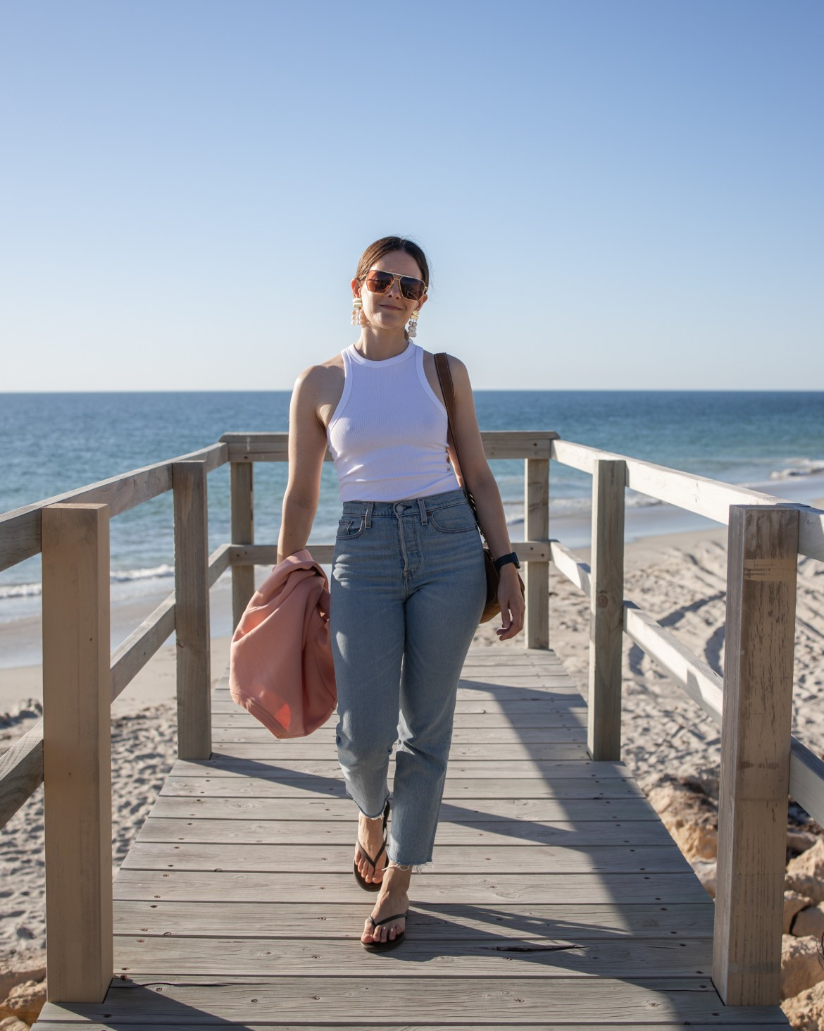 A chic outfit idea with blue jeans and a white top from Shopbop
