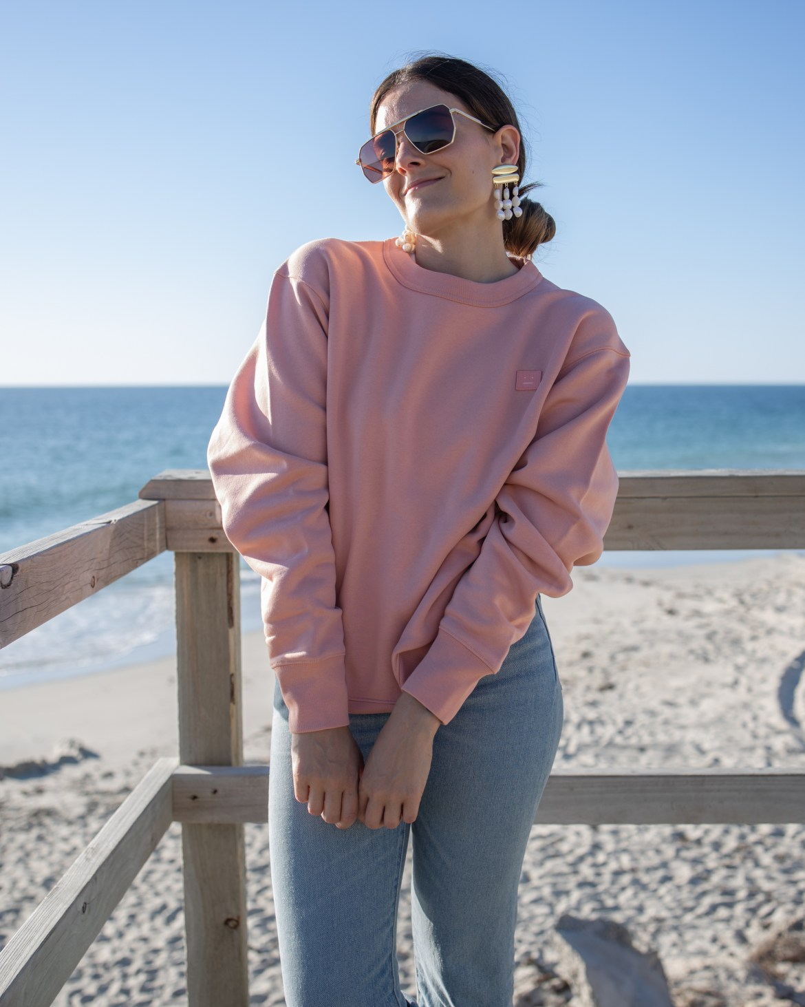 Acne Studios pink sweater outfit at the beach