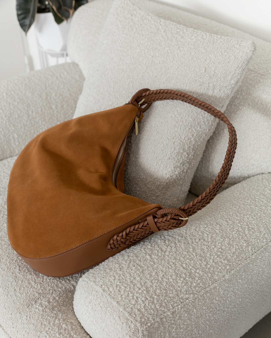 Suede handbag on a boucle chair