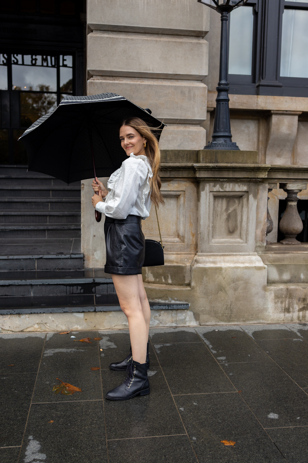 Sezane outfit with black leather shorts