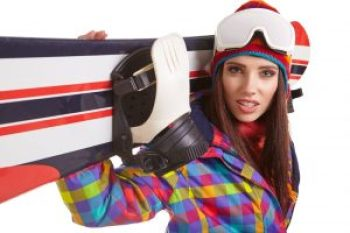 Young woman standing with snowboard isolated on white