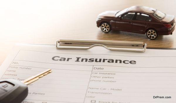 car insurance application form with car model and key remote on desk.