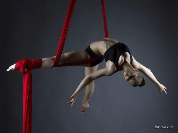 Image of elegant girl doing acrobatic trick