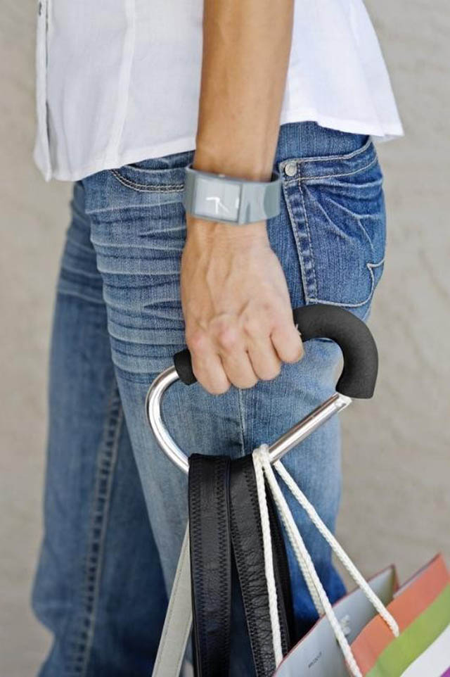 A cushioned handbag carrying clip to keep your fingers from hurting.