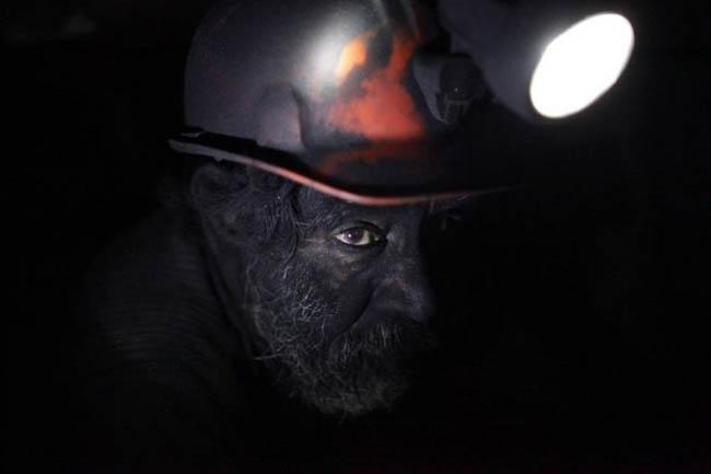 Man working in a coal mine.