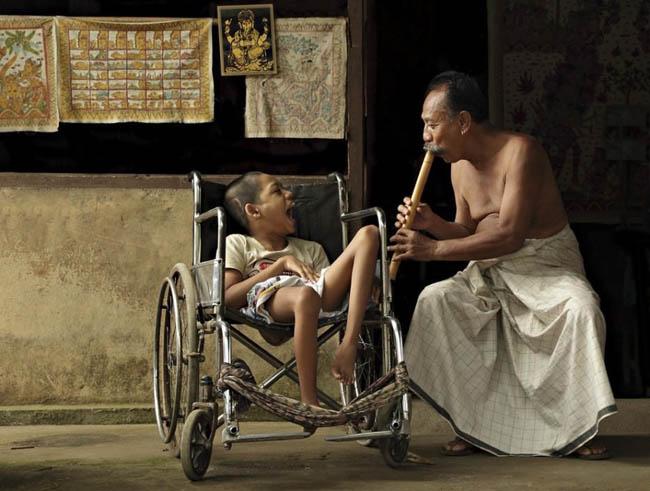 A man was playing bamboo music in Tenganan Village, Bali (2010)