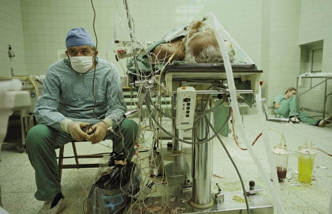 Dr. Religa monitors his patient's vitals after a 23 hour long heart transplant surgery.