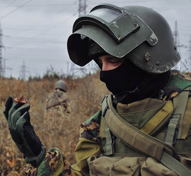 Russian special troops soldier with a butterfly on his fingers.