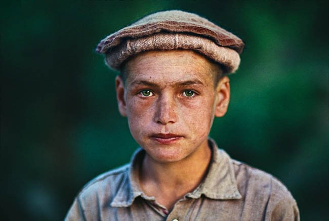 A boy with green eyes from Afghanistan.