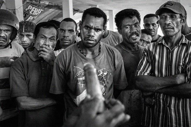 Demonstration of condom usage at a public market in Jayapura, capital of Papua, 2009