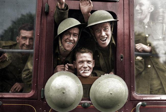 British troops cheerfully board their train