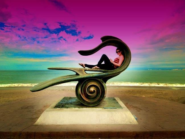 Statue on the beach in Puerto Vallarto, Mexico.