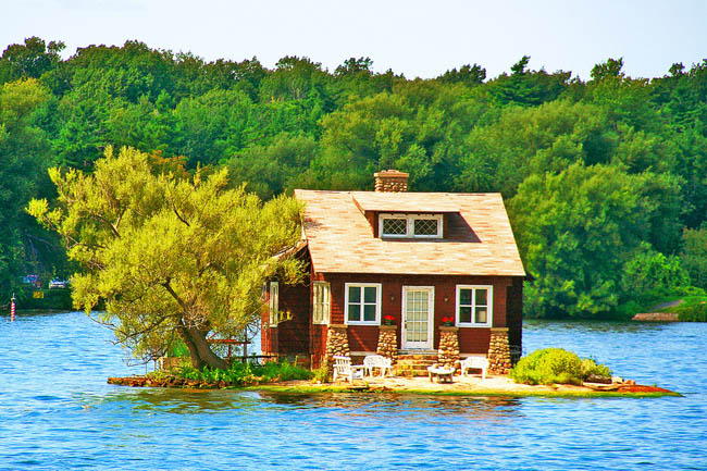 House in the lake with cool porch in Thousand Islands, Canada.