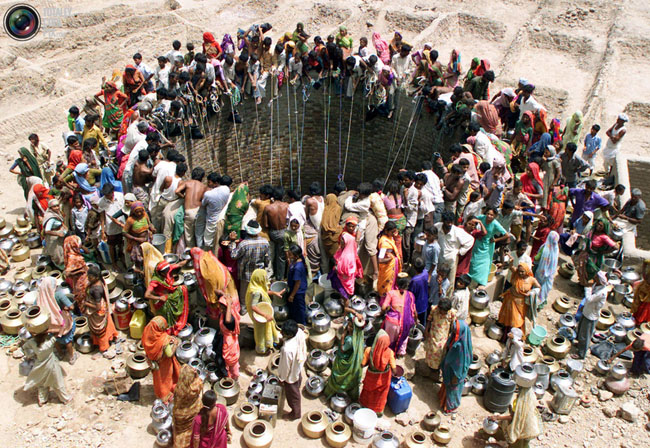 People gather water from a huge well in the village of Natwarghad in the western Indian state of Gujarat.