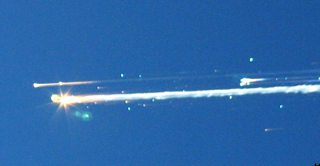 21st century photos - The Columbia Space Shuttle breaks apart during re entry [2003]