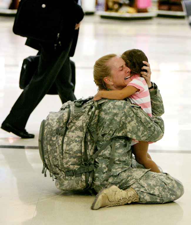 21st century photos - Terri Gurrola is reunited with her daughter after serving in Iraq for 7 months. [2007]