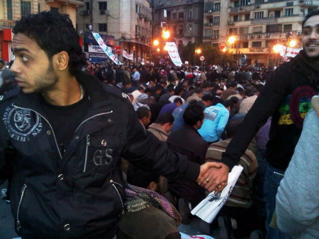 21st century photos - Christians protect Muslims in prayer at Tahrir Square during the Egyptian Revolution [2011]