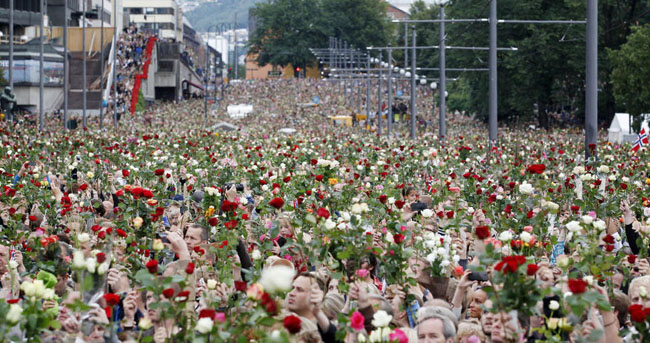 Norwegian citizens hold a flower march after terrorist attacks by Anders Breivik killed 77