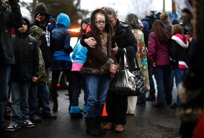 A mother comforts her daughter after the Sandy Hook shootings [2012]