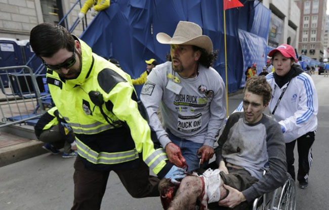 Carlos Arredondo helps Jeff Bauman after the Boston Marathon bombings. The two are now best friends. [2013]