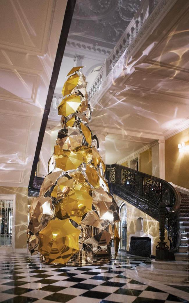 Christmas tree made up of metallic umbrellas in the Claridge's Hotel in London, England