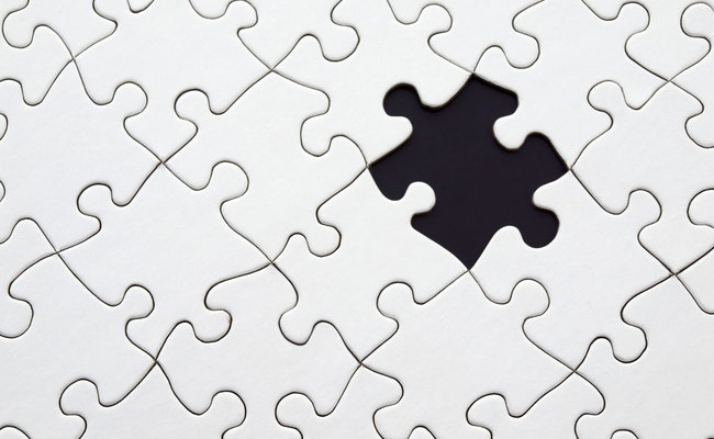 Puzzle with a missing piece.