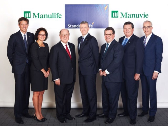 Senior executives from Manulife and Standard Life gather in Montreal for the announcement of Manulife's acquisition of the Canadian operations of Standard Life plc.