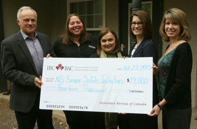 Amanda Dean, Vice-President, Atlantic, IBC gives a cheque to support seniors' programs (Insurance Bureau of Canada)