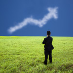 Businessman stand in the meadow and watch the business profit gr