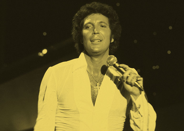Singer Tom Jones sports a shirt revealing his storied chest hair