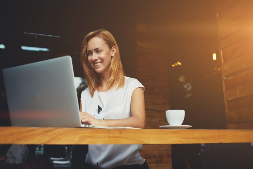 Insynq Girl with laptop and coffee in office image