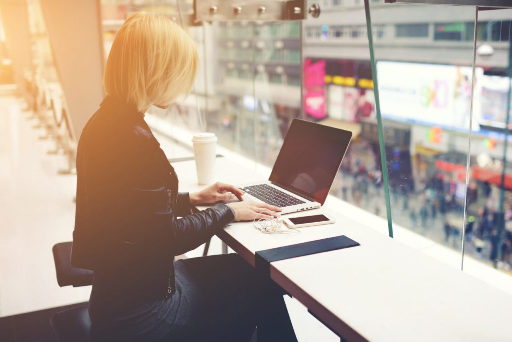 seize momentum, lady in black on laptop image